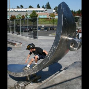 "Z Board @ Wiggums Hollow Skatepark, Everett, WA; Public Art Project, Collection of City of Everett. Stainless Steel, 2011, 10""H x 4'W; $20,000"