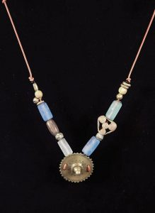 Sawblade; Brass, Glass, brass, woodden beads, Leather cord - $85