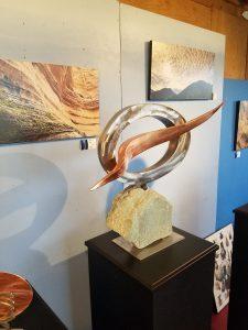 "Lightning; 2019; Stainless Steel,Copper,Metamorphic Stone; 22""H x 24""W x 7""D; $2,800"