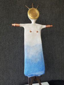 "Blue & Brass Goddess; 2021; Concrete, Brass, Steel, Copper; 34""H x 15""W x 14""D; $1,250"